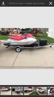 Pair of Yamaha waverunners with trailer