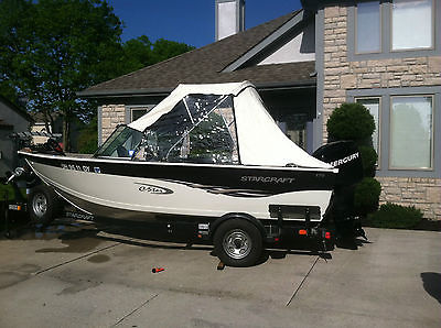 2006 starcraft cstar 17' fish and ski boat White and black in color
