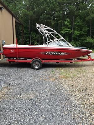 2006 Moomba Mobius LS Boat, Motor, and Trailer, red in color, like new