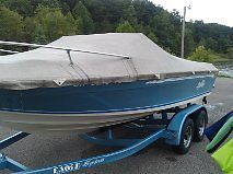 Blue and White 19ft Sylvan Bowrider Boat w/ Tandem Trailer
