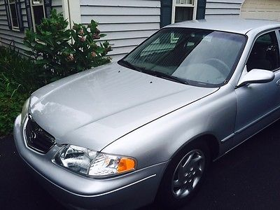 Mazda : 626 LX Silver 4 Dr Sedan.  Body and Engine is in good shape.  Reliable transportation