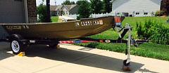 Lowe 12 ft flat bottom. Boat trailer--55 thrust trolling motor. New battery