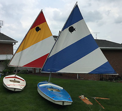 2 Sunfish Sailboats & Double Deck Trailer fully equipped ready to be sailed.
