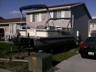 20 ' boat with two biminis, an alternate electric motor, new seats & seat backs