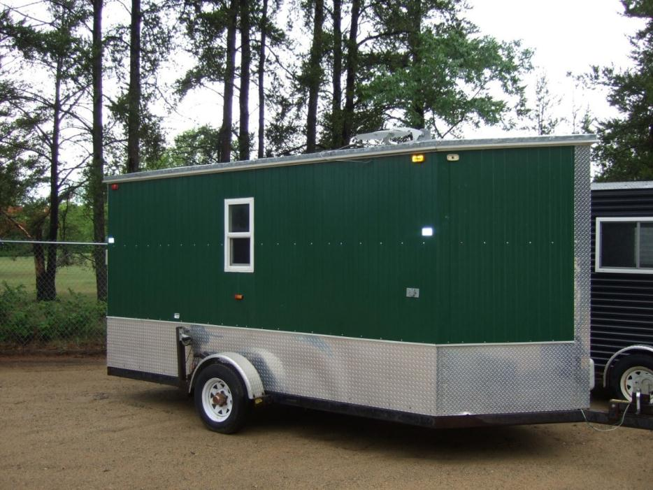 Ice castle fish houses rvs for sale in minnesota for Toy hauler fish house