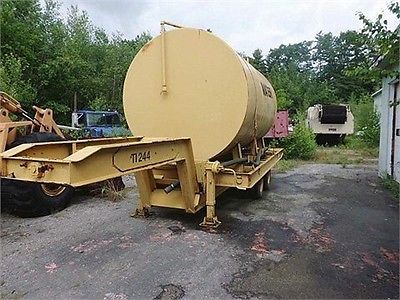 MILLER TILT TOP TAG A LONG TRAILER WITH 5,000 GALLON WATER TANK