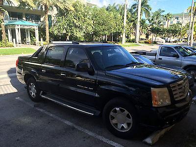 Cadillac : Escalade EXT 6.0 l sunroof cd 10 way power adjustable drivers seat 4 doors