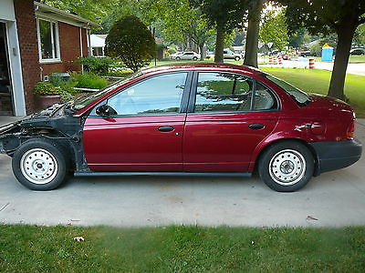 Saturn : S-Series 1998 saturn sl 1 blown engine being sold as a parts car
