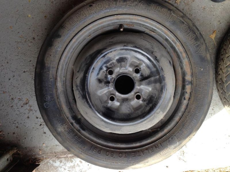 Spacesaver Temporary Mini Spare Tire, size T135/70D15, in good conditi