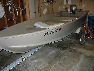 14ft Alumacraft w/ 15hp Honda 4 stroke w/Shoreland'r galvinized trailer. **MN**