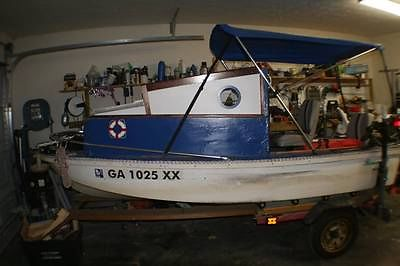 Small fresh water fishing boat well equiped. include motors and trailer