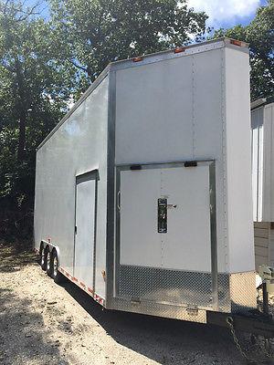 Classic enclosed stacker trailer, 4,000 lb lift, triple axle, aluminum floor