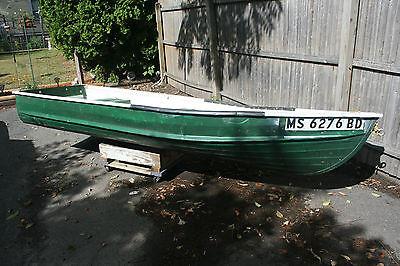 Green aluminum fishing boat, 12 ft, 3 bench seats