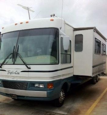 Luxury class A 2001 Tropi-Cal National 34 ft with large slides (wonderful deal!)