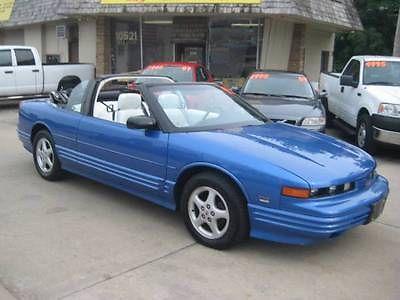 Oldsmobile : Cutlass 1995 oldsmoblie cutlass supreme convertible bright blue w white leather nice