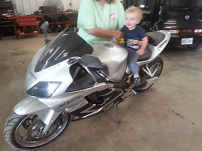 Honda : CBR silver , has steering control, stretch control arm , new rear tire and fresh oil