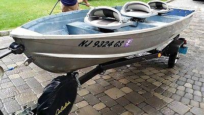 Grumman Bandit 14ft Aluminum Vhull Boat + COX Tilting Trailer GW 1000