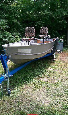 Vintage 1969 Model 15 Aluminum Boat with 9.5hp Evinrude Motor & Tilting Trailer