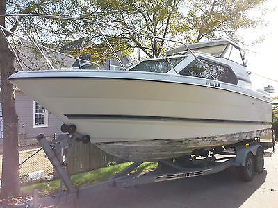 1998 Bayliner 2452 with Mercruiser 5.0 & double axle Magic trail roller trailer