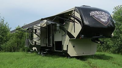 2014 Momentum 5th Wheel Toy Hauler - 42.9 Feet