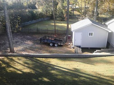14ft trailer with double axles, electric breaks, only used 2 times bought new...