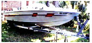 20ft cuddy cabin with a 175v6 Evinrude and aluminum fast load trailer.