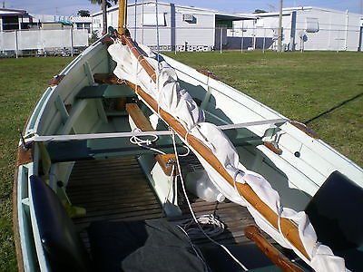 nice wooden dinghy, gaff rig.