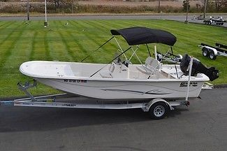 2013 CAROLINA SKIFF 218 DLV SERIES, SUZUKI 115HP 27HRS, BIMINI, W/ ALUM TRAILER