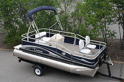 16 ft pontoon boat 15 hp four stroke Honda and trailer.