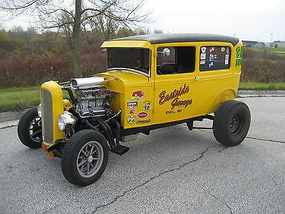 Ford : Model A Model A Tudor Sedan 28 ford sedan presented as a 60 s drag race car