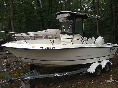 2004 Sea Boss 210 CC Center Console fishing boat Johnson 150 Saltwater edition