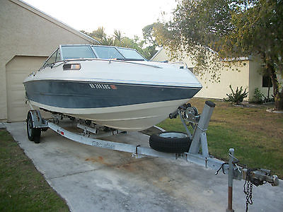 1989 20ft Stingray power boat with a V8 mercruiser and trailer.