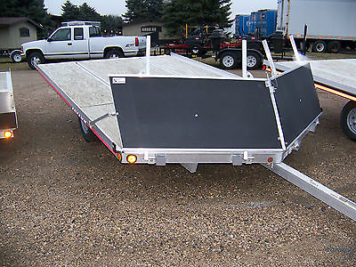 New Triton Snowmobile Trailer model Elite 12VR-101 with drive off rock guard.