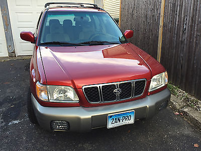 Subaru : Forester S Deep burgundy red, tan interior.  Very clean.  Runs excellent.