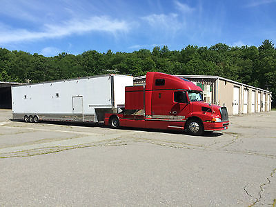 Volvo 660 toter w/48 foot enclosed 4 car hauler